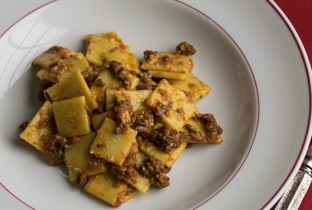 Corn pasta squares with beef and mushroom ragu