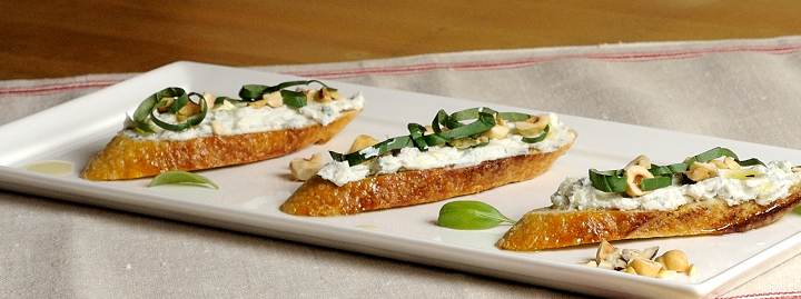 Crostini with Ricotta, Gorgonzola Dolce, Toasted Hazelnuts, and Basil
